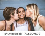 lesbians mothers with adopted... | Shutterstock . vector #716309677