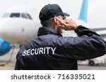 Rear View Of A Security Guard...