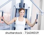 young woman at the gym... | Shutterstock . vector #71634019