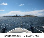 Small photo of Motor boat at blue Baltic Sea on a beautiful sunny day, Aland, Finland.