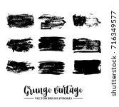 set of black brush stroke and...   Shutterstock .eps vector #716349577