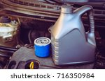 oil filter and engine oil | Shutterstock . vector #716350984