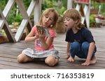 portrait of children outdoor | Shutterstock . vector #716353819