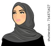 muslim woman in a hijab. white... | Shutterstock .eps vector #716371627