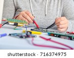 repair on electronic printed... | Shutterstock . vector #716374975