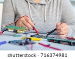 repair on electronic printed... | Shutterstock . vector #716374981