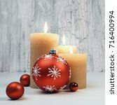 three burning candles with red... | Shutterstock . vector #716400994