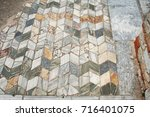 Small photo of Marble opus Mosiac floor from the ruins from Ancient Philippi are from the area known as the Bishop's palace which date as early as the 4th century BC.
