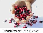 medical drug in hand patient ... | Shutterstock . vector #716412769
