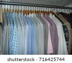 hangers in closet | Shutterstock . vector #716425744
