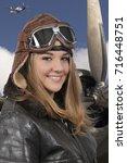 woman pilot wearing vintage... | Shutterstock . vector #716448751