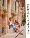 beautiful pretty woman walking... | Shutterstock . vector #716450629