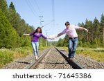young happy couple walking on...   Shutterstock . vector #71645386