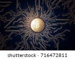 gold coin bitcoin on a black... | Shutterstock . vector #716472811