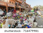 Small photo of Jaipur, India, 9th January 2017 - Children and dogs rummage thru garbage in the street in Jaipur, India