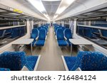 empty train interior with blue... | Shutterstock . vector #716484124