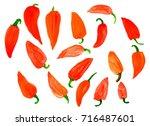 a lot of red sweet pepper ...   Shutterstock . vector #716487601