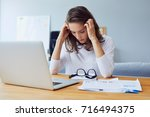 stressed young entrepreneur... | Shutterstock . vector #716494375