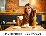 attractive young woman smiling... | Shutterstock . vector #716497201