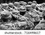 us soldiers giving salute  bw | Shutterstock . vector #716498617