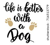 life is better with a dog. hand ... | Shutterstock .eps vector #716513779