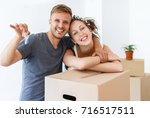 couple showing keys of a new... | Shutterstock . vector #716517511
