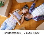 moving in new home. couple...   Shutterstock . vector #716517529