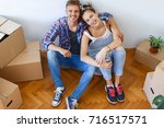 moving in day. happy couple... | Shutterstock . vector #716517571