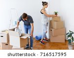 young couple in love moving in... | Shutterstock . vector #716517595