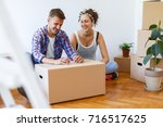 unpacking boxes in a new... | Shutterstock . vector #716517625