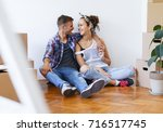 moving in to a new home. young... | Shutterstock . vector #716517745