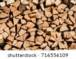 a pile of stacked firewood ... | Shutterstock . vector #716556109