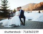 winter wedding outdoors on snow ... | Shutterstock . vector #716563159