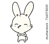 curious bunny cartoon   Shutterstock .eps vector #716573035
