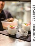 Small photo of Raspberry dessert, cheesecake, trifle, mouse in a glass on a wooden background.