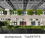 aerial view of car parking top... | Shutterstock . vector #716597575