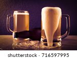 beer in mug on concrete table... | Shutterstock . vector #716597995