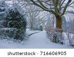 a snowy winter scene with... | Shutterstock . vector #716606905