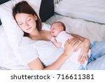 newborn baby sleeping in the... | Shutterstock . vector #716611381