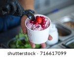 stir fried ice cream rolls at... | Shutterstock . vector #716617099