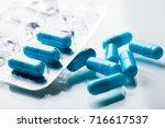 pharmacy theme  blue medicine... | Shutterstock . vector #716617537