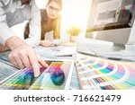 graphic designer at work. color ... | Shutterstock . vector #716621479