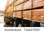 Small photo of Timber transport truck Park waiting for inspection with lumber for construction.selective focus