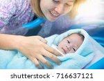 portrait of asian newborn and... | Shutterstock . vector #716637121