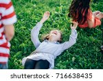 Small photo of Children lie on the grass. Children lie on the grass.