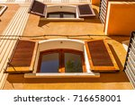 window shutters on an old... | Shutterstock . vector #716658001