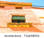 window shutters on an old... | Shutterstock . vector #716658031
