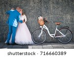bride and groom with a bicycle... | Shutterstock . vector #716660389