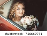 lovely young bride in wedding... | Shutterstock . vector #716660791