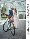 bride and groom with a bicycle... | Shutterstock . vector #716661721